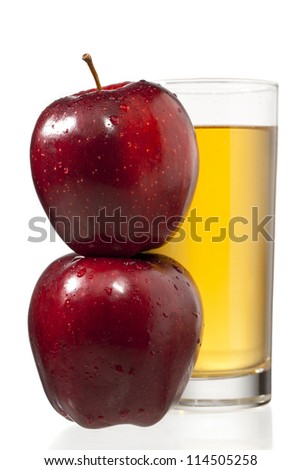 stack of apples and juice glass - stock photo