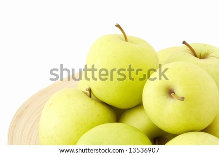 stack of apples on wooden plate