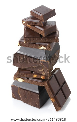Stack of assorted broken dark chocolate pieces isolated on white background.