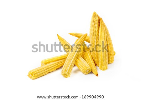 Stack of baby corn cobs isolated on white background