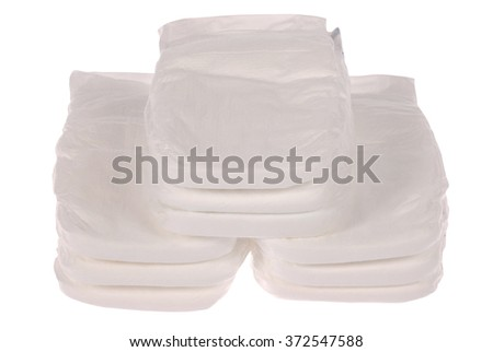 Stack of baby diapers on white. Clipping path included.
