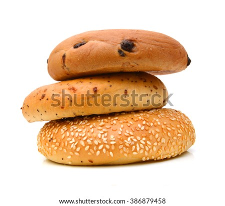 Stack of bagels on white background  - stock photo