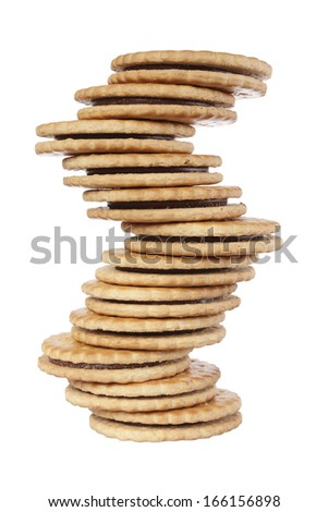 Stack of balanced biscuit. Isolated on white background