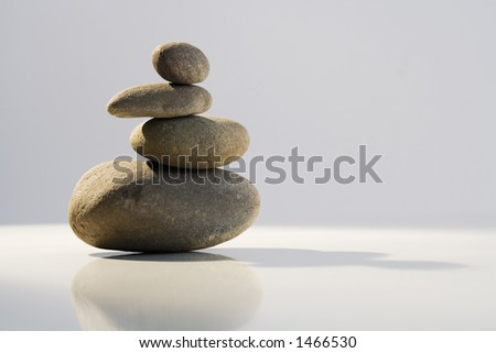 Stack of balanced stones in Zen-like setting - stock photo