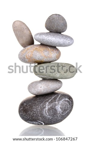 Stack of balanced stones isolated on white