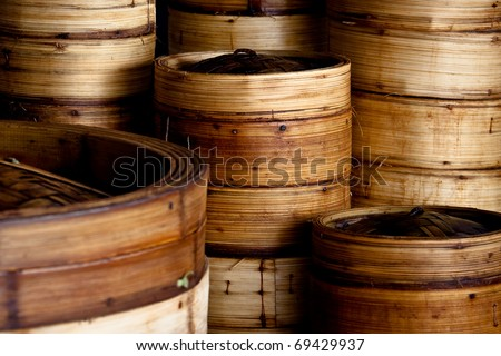 Stack of bamboo rice steamers - stock photo