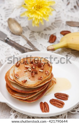 stack of bananas pancakes with pecan and honey - stock photo