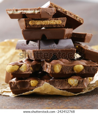 stack of bars pieces of chocolate with different flavors - stock photo