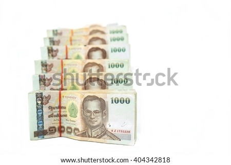 Stack of 1000 bath Thai money : Thailand Currency 1000 Bath, BankNotes isolated on white background with copy space and text here for your design  - stock photo