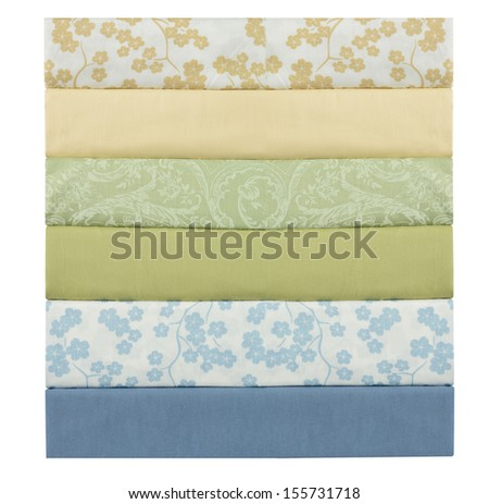 Stack of bed sheets. - stock photo