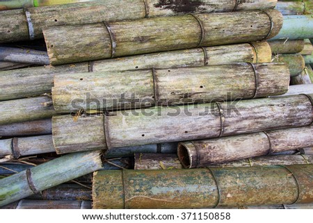 Stack of big old bamboo cutting pipe for comstruction, Textured background - stock photo
