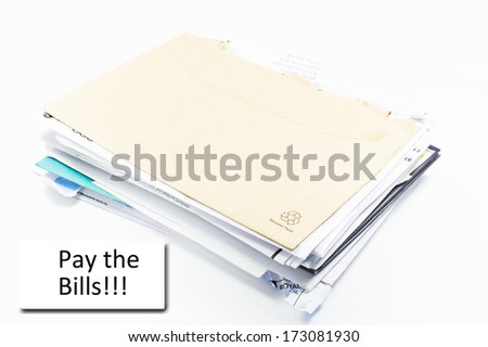 """Stack of bills to pay with text """"pay the bills"""" - stock photo"""