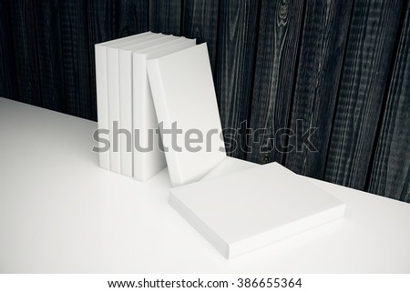 Stack of blank white books leaning on dark wooden wall. Mock up, 3D Render - stock photo