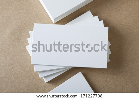 Stack of blank white business cards on crafts background - stock photo