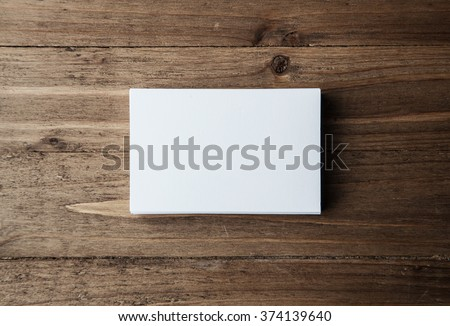 Stack of blank white business cards on wooden background Horizontal - stock photo