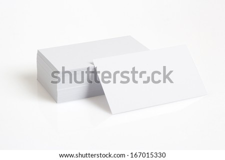 Stack Of Blank White Businesscards on White Background - stock photo