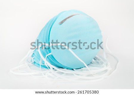 Stack of Blue, Disposable, Protective Dust Masks . - stock photo