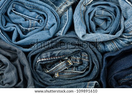 Stack of blue jeans as a background or texture - stock photo