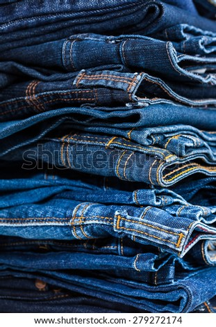 Stack of blue jeans - detail - stock photo
