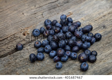 Stack of blueberries, on wooden surface