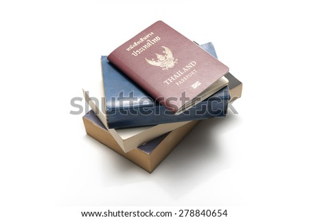stack of book and passport isolated on white background