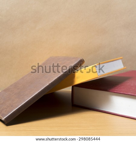 stack of book on wood background - stock photo