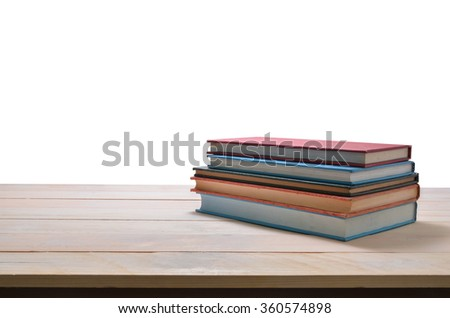 stack of book on wooden table isolated on white background