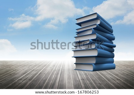Stack of books against sky