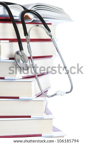 Stack of books and a stethoscope medical on a white background. - stock photo