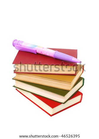 stack of books and a very large ball-point pen isolated on white