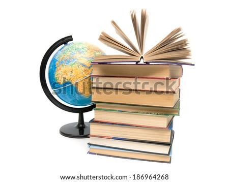 stack of books and globe on white background. horizontal photo. - stock photo