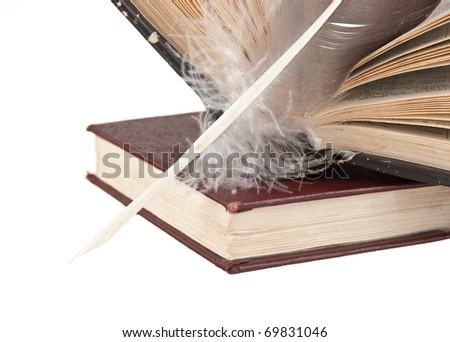 stack of books and quill isolated on white background