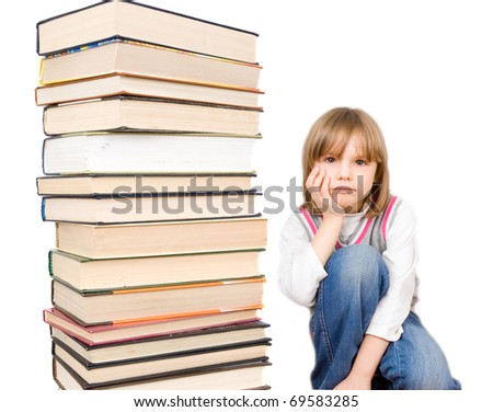 Stack of books and sad child