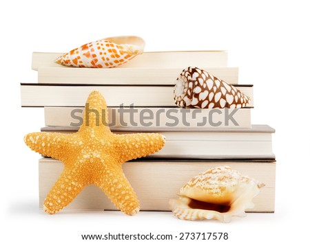 stack of books and seashells isolated on white background - stock photo