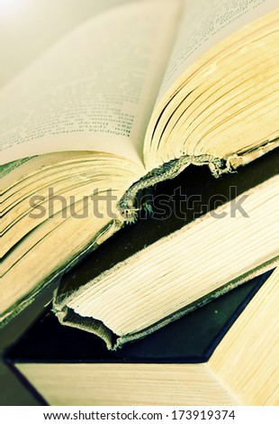Stack of books close up.Book opened. - stock photo
