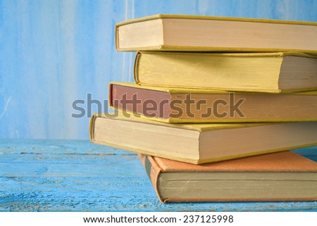 stack of books close up, free copy space - stock photo