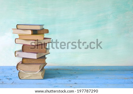 stack of books, grungy background,free copy space - stock photo