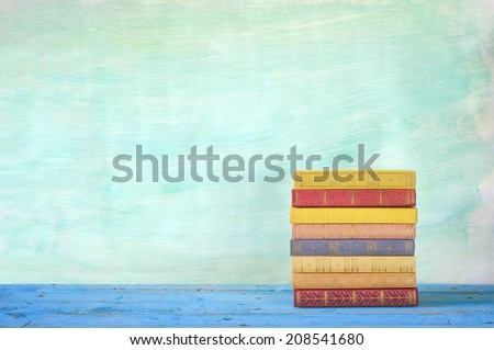 stack of books, grungy background, free copy space  - stock photo