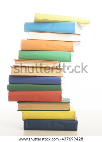 Stack of books isolated on white background at wooden table. Education concept. Back to school - stock photo
