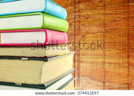 Stack of books isolated on wooden background