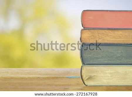 stack of books, nature background,free copy space - stock photo