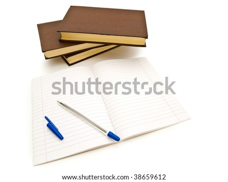 stack of books near empty open notebook with pen against the white background