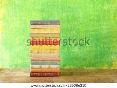 stack of books on grungy background,free copy space - stock photo