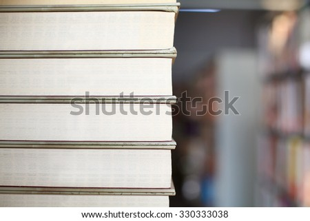 Stack of Books on Library Shelf - stock photo