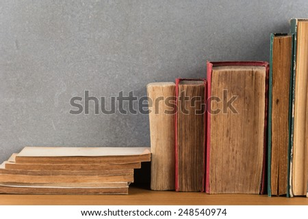 stack of books on wood table - stock photo
