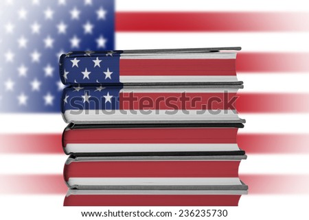 Stack of Books over American Flag.American Education System Concept. - stock photo