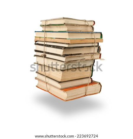 Stack of books tight up with rope over white background