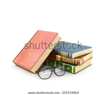 Stack of books with a pair of eyeglasses. - stock photo