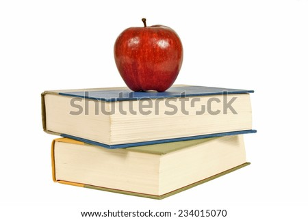 Stack Of Books With Big Red Apple Isolated On White Background