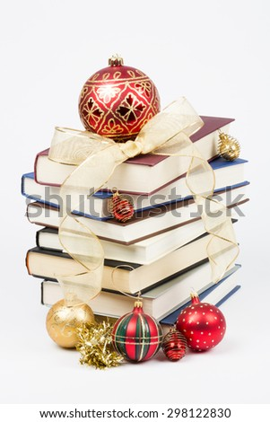 Stack of books with Christmas decorations isolated on a white background - stock photo